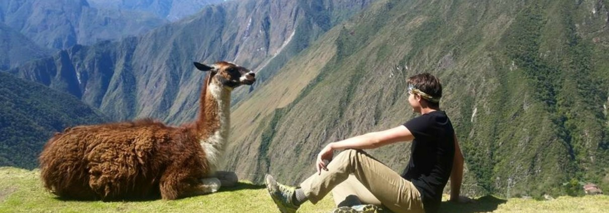 student with llama in Peruvian Andes