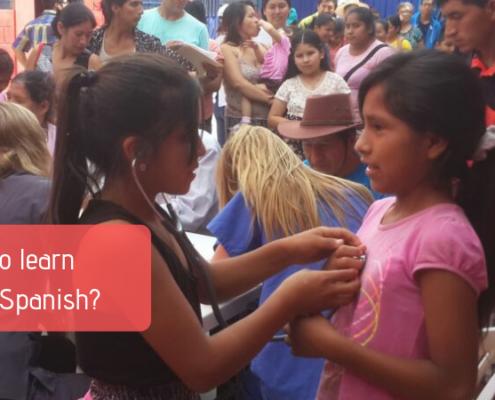 Two girls attending Community Health Fair in Peru